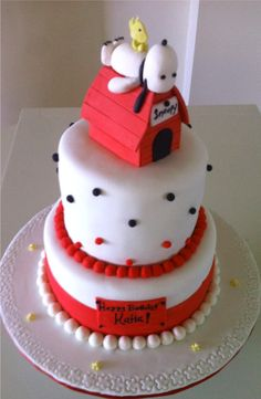Snoopy and Woodstock on doghouse two-tier cake