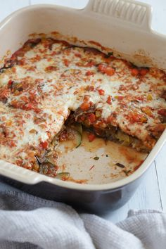 Baked Ratatouille with Havarti  Cheese veggies vegetables side dish 1 medium eggplant, sliced 1/8th inch thick 2 tsp kosher salt 1 tbsp olive oil 1/2 small onion, diced 3 garlic cloves, crushed 1/8 tsp cracked black pepper 2 cups crushed tomatoes 1/8 tsp red pepper flakes (optional) 1 bay leaf 1 teaspoon fresh thyme 4 fresh basil leaves, finely chopped 1 small red bell pepper, diced 1 small yellow bell pepper, diced 1 small (6 ounce) zucchini 1 smalll (6 ounce) yellow squash