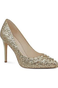 Whether its walking the red carpet or heading out for a night on the town, this glitter-struck pointy-toe pump is an absolute showstopper.