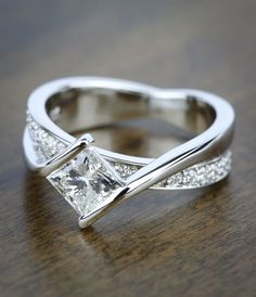 A beautiful Bezel Bridge Princess Cut Diamond Engagement Ring in White Gold! See more of our recently purchased rings by clicking through this Pin! #princesscutring