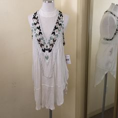 HPFree People Mock Neck Jersey Tunic in XS NWT Free People white mock neck jersey tunic with mesh inset and beading in XS, NWT Free People Tops Tunics