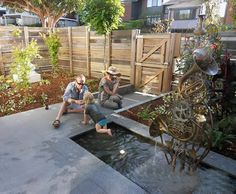 A family enjoys a French Horn fountain installed in a wonderful urban back yard setting in Australia.