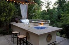Outdoor kitchen with bar top pit