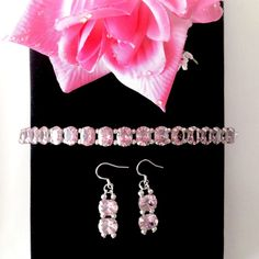 The Rose Garden 8 inch tennis bracelet and 1.75 inch earring set features a series of 2.5 carat faceted oval cut pink Cubic Zirconia with sterling silver embellishments and findings.