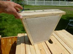A candy board insert for a top bar hive.