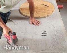 Construct a small, round patio table with a tiled plywood and cement board top and hand-bent metal legs.