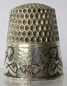 """""""Seated Cherubs"""", by Webster Bros. One of the rarer cherub thimbles. Cherubs are all facing the same direction with a swag of leaves between them. Vintage Sewing Notions, Vintage Sewing Machines, Sewing Tools, Sewing Hacks, Vintage Silver, Antique Silver, Little Mercerie, Sewing Baskets, Sew Ins"""