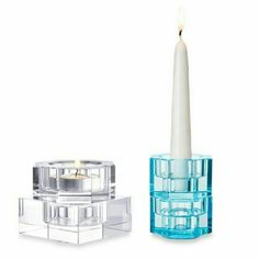 "SOLD! Orrefors Tranquility Votive Candleholders Indulge your artistic side with Orrefors' beautiful, interactive Totem Tranquility Votive Holders Each votive holder is stackable Mix and match Totem Balance, Harmony, Serenity, and Tranquility Votive Holders to create your own unique look (each set sold separately) Set of 2 Blue Translucent Lead crystal Hand wash Measures 2.38"" diameter x 3.5"" H Imported Orrefors Accessories"