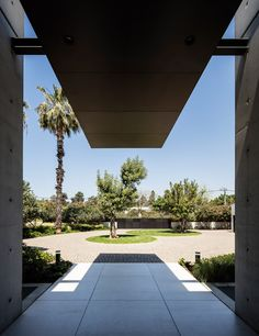 Concrete and glass surfaces extend from inside to outside of Israeli house