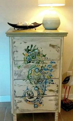 Furniture makeovers with paintings: http://www.completely-coastal.com/2016/01/dresseer-makeover-coastal-beach-nautical.html