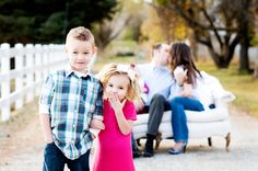 Family pic ideas: focus on close up of kids with mom and dad blurring in the background