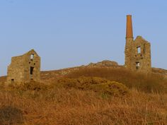 The ghostly ruins of Cornish tin mine wheel houses dot the Cornish landscape, some in spectacularly pecarious coastal scenery.  Often the mines reached out under the seabed.