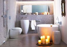 A simple yet elegant bathroom.  I love the curves and unconventional shapes!  Very relaxing ...