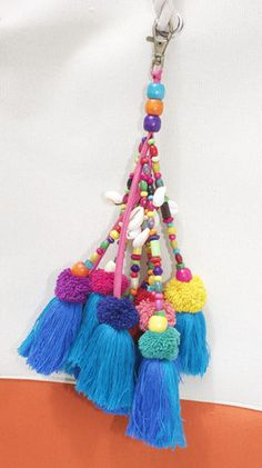 - 10 Individual strands of colored wooden beads, cowrie shells, two tone tassels and handmade pompoms - bead color will slightly vary - lobster clas - two week ship time Diy Tassel, Tassel Jewelry, Textile Jewelry, Diy Jewelry, Tassels, Pom Pom Clutch, Diy And Crafts, Arts And Crafts, Passementerie