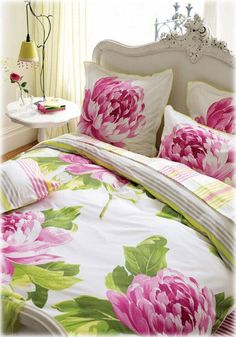 Bright Bedding with White Bedframe.