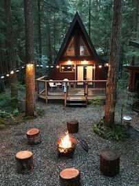 Rustic A-Frame with a cozy modern interior. – Glacier Rustic A-Frame with a cozy modern interior. Tyni House, Tiny House Cabin, Cabin Homes, A Frame Cabin, A Frame House, Modern Stoves, Forest Cabin, Forest Home, Rustic Home Design
