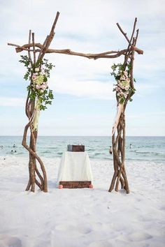 Beautiful Beach Ceremony Alter with Wooden Arbor