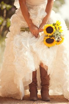Such a pretty #wedding photo with the bride's gorgeous gown, lovely sunflowers, and fun cowboy boots! From http://stylemepretty.com/2012/12/17/villa-parker-wedding-from-chris-adrienne-scott-photographers/ Photo Credit: http://chrisandadriennescott.com/