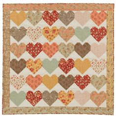 Make this quilt for someone you love! Easy-to-piece hearts give the look of applique with simple, straight-line sewing.