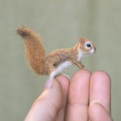 Special order reserved for Patricia. A tiny squirrel needle felted with naturally dyed wool. He is made with a wire armature so he is pose-able. 2 inches tall when sitting.
