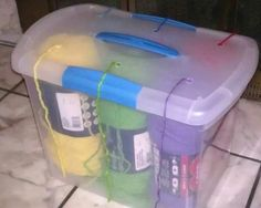 If you'd prefer for your yarn holder to have a lid, try a plastic bin like this one. If you'd prefer for your yarn holder to have a lid, try a plastic bin like this one. Yarn Storage, Storage Bins, Craft Storage, Storage Ideas, Storage Hacks, Knitting Storage, Crochet Storage, Storage Containers, Storage Solutions