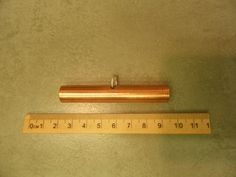 a hand made copper tube type needle case based on a find in the national museum of Ireland, dated to the 10th century Viking period, nominally 7cm long