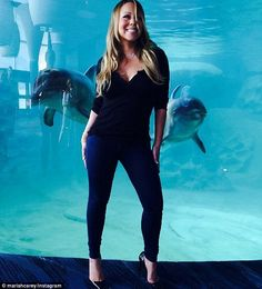 Out diva-ing the diva! Mariah Carey found a couple of incredibly photogenic dolphins to po...