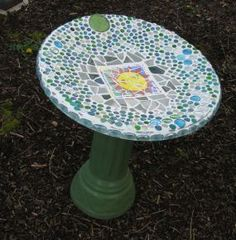 Some tiles and lots of glass nuggets later...recycle an old satellite dish and keep it from the landfill!
