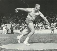 Oregon track athlete Neal Steinhauer throws a discus during a 1966 track meet at Hayward Field. From the 1966 Oregana (University of Oregon yearbook). www.CampusAttic.com