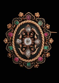 An antique rose cut diamond brooch / pendant set with rubies and emeralds. 19th century, France. 18k gold and enamel.