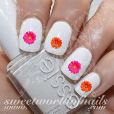 Daisy Flower Nail Art Nail Water Decals Transfers Wraps 20 water decals on a clear water transfer which can be applied over any color varnish on either your natural or false nail. Use: 1. Paint nails