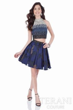 Beautiful two piece homecoming dress embellished in tri-color ombré beading. The high shine mock neck cropped top is paired with a box-pleated organza jacquard flared skirt, finished with matching beadwork at the waistline.