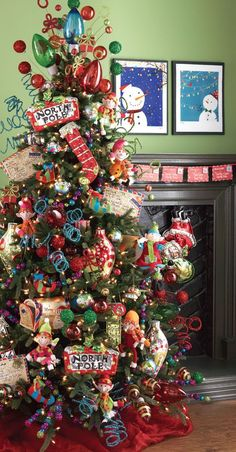 What an Adorable Christmas Tree! My daughter would love it! Love the Oversized Christmas Bulbsused as a Topper and the North Pole Signs! Postmark Christmas Tree Decorations #Fun #Trendy #Stylish #Christmas #Tree #Decorations #Ideas