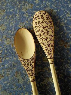 Wood-burned wooden spoon with scrolls and vines