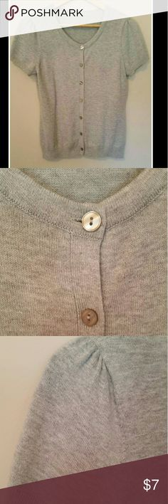 "Gray Cardigan Short sleeved gray button down cardigan - cute gathered stitching at shoulders - soft ribbing at sleeve ends and bottom edge - no tag or fabric content noted however very soft knit per feel - extra button sewn inside also - im a 6/8 or medium and it fits me..chest measures 17"" before stretch and length is 22 1/2"" - im stating size M Sweaters Cardigans"