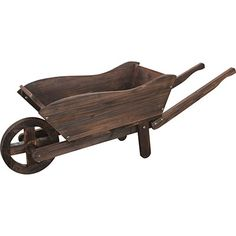 Made with durable cedar wood with a rustic antiqued finish, this Wooden Wheelbarrow Planter adds character to any garden. Wooden Wagon, Wooden Pallets, Wooden Diy, Wooden Signs, Wooden Planters, Outdoor Planters, Wagon Planter, Wheelbarrow Planter, Medieval Furniture