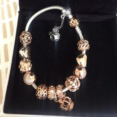 Pamdora Rose gold bracelet Pandora rose gold bracelet , with 12 charms. Gorgeous bracelet. Pandora Jewelry Bracelets
