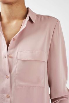 Hit refresh on the classic shirt with this clean style. Equal parts smart and still feminine, it features button down detailing and a twin breast pocket. Try styling with denim and mid-heels for pared-back nonchalance. #Topshop