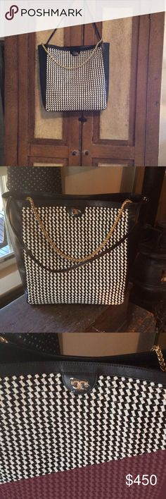 Tory Burch Erica Woven Leather Large Hobo Tory Burch Erica Woven Leather Large Hobo, Black / White Multi Buttery leather.  Gold Chain handle and leather detachable handle. Tote size is 14 x 14. Amazing one of a kind hard to find tory.  Authentic Tory Burch Bags Totes