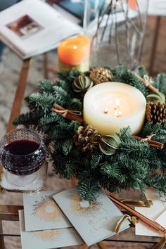 Small real Christmas wreath used as a coffee table accessory with a large The White Company Winter candle in the centre. Christmas Love, Christmas 2019, Christmas Holidays, Christmas Tree Decorations, Christmas Wreaths, Table Decorations, Coffee Table Accessories, Eucalyptus Garland, Dried Oranges