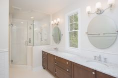 Owners Suite: ceramic tile floors, stained cabinets, quarts counters, coordinating ceramic tile backsplash and shower surround with glass entry