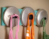 upcycled reclaimed pegged rack using pot and pan lids...cuz I don't cook so might as well get some use outta 'em!