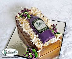 Wine bottle cake. All Edible except wires that the grapes are on. Bottle is cake. Shredded paper in wine box is rice paper that I cut, crump...