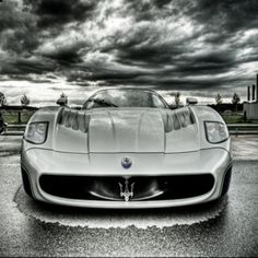 Masarati...in love.  Yummy...... oh to zip around town in this one ....