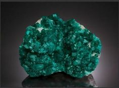 Dioptase(Two Generations) on Calcite, Tsumeb Mine (Tsumcorp Mine), Tsumeb, Otjikoto Region (Oshikoto), Namibia. Overall Measurements: 4.64 x 3.45 x 1.59 inches (11.81 x 8.77 x 4.04 cm). Sold for  $46,875.