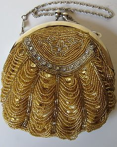 VINTAGE GOLD BEADED EVENING BAG. I know these bags are heavy,unless you just carried lipstick,powder and your ID!.