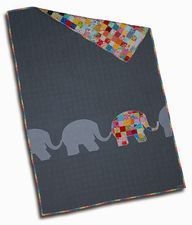 I love this clever patchwork quilt. The elephant is so cute. This is a delightful quilt!