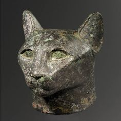 Egyptian Bronze Head of a Cat  Culture  : Egyptian  Period  : Late Period, (6th-4th Century B.C.)  Material  : Bronze  Dimensions  : H: 10.5  Price  : SOLD  Provenance  :    Ex-Bela Hein collection, acquired before 1931.  Conditions  : This hollow cast head is whole but has been reassembled from a number of pieces. The black-colored surface of the metal is partially covered with areas of green patina. The bronze walls are quite thick. The eyes of the cat were fashioned from another material…