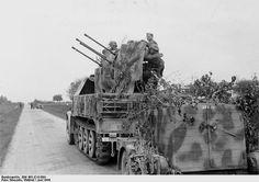 German Flakvierling 38 anti-aircraft gun mounted on the back of a halftrack vehicle, France, Jun 1944.