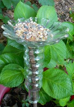 This small glass bird feeder is a perfect accessory for your lawn, backyard, or garden. Just slip it over a dowel, stake or copper pipe and insert into the lawn, or planter like shown in the picture.